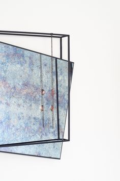 German designer Meike Harde has created a pair of patterned mirrors for Pulpo with protruding frames that double as storage.