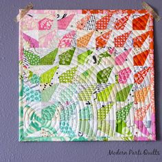 I love the way this is quilted. Modern Parti Quilts: Wonky Rainbow Burst Mini Quilt