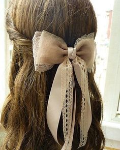 part of me really wants to start putting bows in my hair... but i need to long hair for it first! hehe
