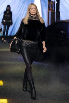 My American Dream - Milan, 23 February 2014. As the stage lights up, a customized black matte Chevrolet El Camino appears at a vintage gas station. The car door opens and British actress/pop star Rita Ora descends, decked out in studs and cowboy hat, and