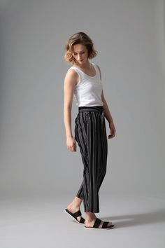 Cut in beautifully soft and breezy viscose, our fine stripe capri is as versatile as it is stylish. Featuring an elasticated waistband and finished with a tie front self fabric belt. Wear relaxed with sandals or trainers and a fresh white tee for an effortless off duty look.