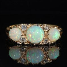 Hey, I found this really awesome Etsy listing at https://www.etsy.com/listing/190343760/colorful-vintage-3-opal-and-diamond-ring