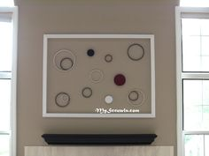 Large inexpensive wall art made from PVC decorative moulding & painted embroidery loops.