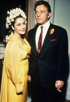 Elizabeth Taylor's first marriage to Richard Burton in 1964...wearing a chiffon gown in daffodil yellow along with lilies of the valley and white hyacinths in her hair.