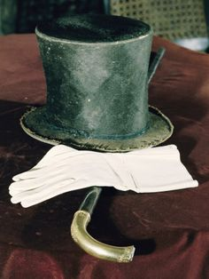 Abraham Lincoln's hat, gloves, and cane.  (Hat has a mourning band)