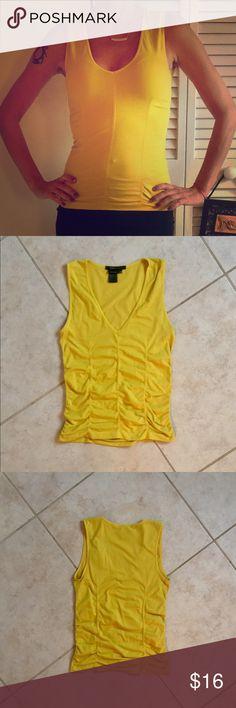 BCBGMaxAzria TOP BCBGMaxAzria yellow v-neck sleeveless top. Great condition. BCBGMaxAzria Tops Tank Tops