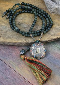 Mala made of 108, 8 mm - 0.315 inch, beautiful jasper gemstones and decorated with a Nepalese filigree dorje - OM pendant. The mala features a detachable tassel - look4treasures on Etsy