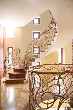 The design of this staircase is beautiful to me. I think it is beautifully designed especially because it is original. It is so different from any staircase I have ever seen before. The curvy metal strands that make up the railings look elegant and certainly catch my eye. What a design!