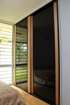 Tasmanian Oak, Frameless black glass. Sliding doors at their most simple and elegant. https://www.formfunctionnt.com.au/