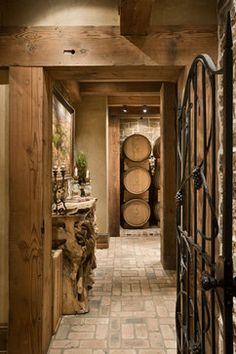 Wine cellar with brick floor. Would set it herringbone style...