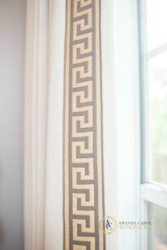used a simple inexpensive linen fabric for the drapery and splurged on this greek key trim from Kravet. I had my workroom line the drapery with blackout lining making these drapes hang flawlessly. I truly believe that custom drapery makes all the world of difference in a space. Its worth every penny!!