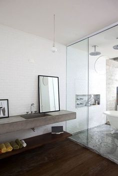 Not crazy about the contemporary looks here, but a claw foot INSIDE the shower... Genius!