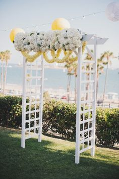 Loving this floral draped altar-- sweet pastels and a seascape in the back. Perfect! {Luminaire Images}