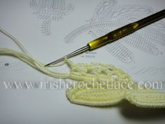 Leaf sprig with small openwork leaves on padding cord