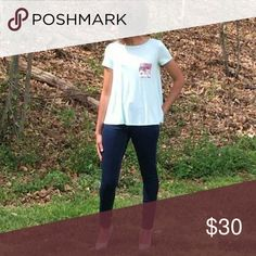 AJ Austin Tee The Austin Tee was designed for comfort but didn't compromise of flattery. Features a floral pocket to give a touch of flare.  Color: Mint My Amelia James Tops Tees - Short Sleeve