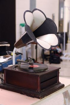 Making a quick and easy gramophone horn out of paper and plastic.
