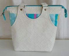 Peekaboo, eggshell/stripes. Small shoulder bag. Made with eggshell coloured vegan suede and blue/pink striped cotton fabric