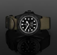Murdered out black carbon coated case. Ceramic bezel. Reed green G10 Military NATO straps fixed with mil-spec bar. Just needs the logo removed.
