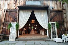 Wedding decor...I like the entrance to wine cellar for reception.