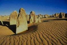 About 250 kilometres north of Perth lies Western Australia's Nambung National Park where you'll find these eerie-looking limestone pillars known as The Pinnacles, just one of the many attractions of Western Australia.