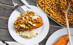 Baked sweet potatoes are topped with spicy, roasted chickpeas and a super creamy vegan cheese sauce that you won't believe is made from cauliflower.