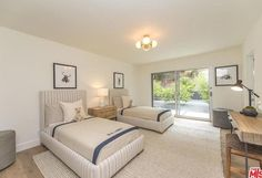Guest ready: The couple's guest room features sliding doors, handy for their lodgers to nip out to the garden