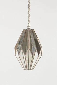 Aisai Pendant Lamp  Constructed of slightly weathered mirrors that glow ethereally when lit, Notre Monde's exquisite fixture brings to mind complex origami folds.