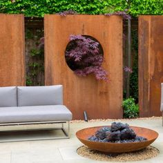Fall in love with your garden this September, by creating a relaxing and functional outdoor area, full of autumnal charm. Corten Steel is a very strong, weather resistant material, which naturally weathers when exposed to the elements; forming a protective layer of rust. #adezz #cortensteel #autumn #garden #loveyourgarden #landscaping #gardendesign #firepit #waterfeature #planters #woodstorage #instantwalling Balcony Design, Fence Design, Garden Screening, Olive Garden, Autumn Garden, Arts And Crafts House, Walled Garden, Outdoor Living Areas, Gardens