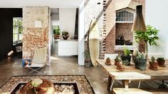 21 Homes That Prove Surf Is Chic // surfboards as decor // exposed brick walls, rustic dining table, cacti, folding chair