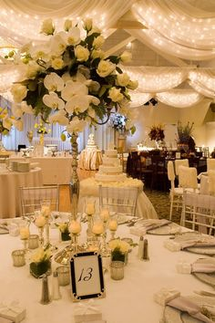 I love the tall center pieces ...maybe with yellow roses or sunflowers? you could just do every couple of tables so it is not too much