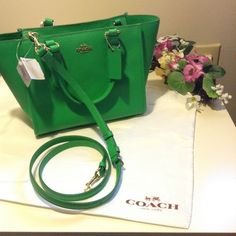 25% off Coach Crosby Carryall  Leather purse Brand: Coach Model: 33996 Material: Leather Print/Solid: Solid Color: Green Condition: New with Tags Size: Medium  Coach Crosby Carryall in Crossgrain Leather   New with tags  Authentic guaranteed  Color: Green  Details  Leather  Inside zip, cell phone and multifunction pockets  Zip-top closure, fabric lining  Handles with 5 drop  Detachable strap for shoulder wear  13 1/2 (L) x7 1/4 (H) x 5 1/2 (W) Coach Bags Crossbody Bags
