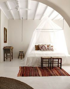 Bed moskito nets and furniture examples.  San Giorgio Hotel – Mykonos