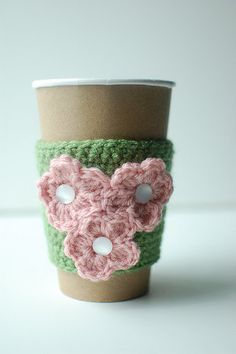 coffee cozy - love the colours, mother-of-pearl buttons, and flowers