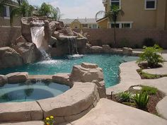 Swimming pool with hot tub, slide and waterfall