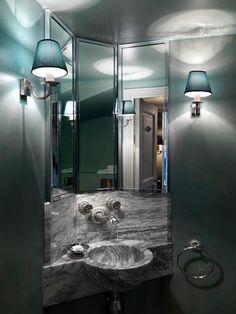 Fantastic marble vanity bowl. Mood lighting playing off the mirrors. Jaques Grange. Paris