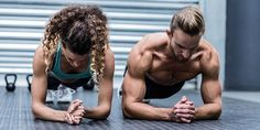 static holds male and female athlete perform plank exercises