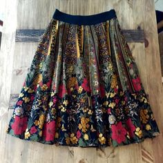 """Anthropologie Viola Skirt 4 Floral patterned full skirt by Viola. Vibrant colors of olive green, yellow, gold, and red accented by black, it has pockets and zips at the side with a hook and eye closure. It's not lined but it's a very substantial fabric so it's not necessary. Waist measures 14.5"""" across and the length is 29"""". Absolutely beautiful and in excellent condition with zero flaws. Anthropologie Skirts Midi"""