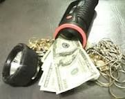 ....like this....I've used this for years, ( that old flashlite that never works , in a corner)  Flashlight safe for valuables