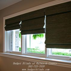 Three natural woven shades side by side with a  blackout liner on the back for privacy