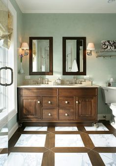 marble floor bordered with porcelain tile that mimics wood. beautiful!