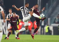 Medhi Benatia of Juventus and Paulinho of Barcelona battle for possession in the air during the UEFA Champions League group D match between Juventus and FC Barcelona at Allianz Stadium on November 22, 2017 in Turin, Italy.