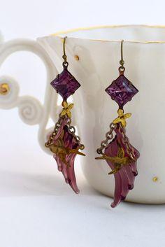 A personal favorite from my Etsy shop https://www.etsy.com/listing/477368022/vintage-purple-earrings-swallow-earrings
