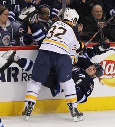 Buffalo Sabres at Winnipeg Jets Game W 4-1- 04/09/2013 John Scott #32 of Buffalo takes down Mark Stuart #5 of Winnipeg at MTS Centre. (Photo by Marianne Helm/Getty Images)