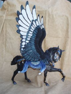 This was an older commission I started last year. A customized Breyer Esprit using Moody wings. only a few small changes *move front leg *moved head and neck *Moody wings *sculpted tack *new mane p. Pretty Horses, Beautiful Horses, Toy Art, Pegasus, Fantasy Creatures, Mythical Creatures, Bryer Horses, Blue Horse, Painted Pony