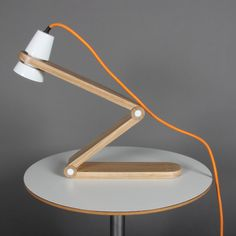 Zygon is a versatile and modern desk lamp that makes use of energy efficient technologies. Powered by 12 LEDs, Zygon offers complete dimmable control during illumination, lending itself useful to both ambient lighting and task lighting. The beautiful use of light and natural wood compliments the architectural white corian lampshade to encourage user interaction. The entire light can be angled up and down to the users preference for additional functionality. - Pierce Coyne