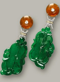 PAIR OF JADEITE, RED JADEITE AND DIAMOND PENDENT EARRINGS Each suspending on a translucent jadeite plaque of rich emerald green colour carved as a Chinese fan atop lingzhi ruyi and bat motifs, surmounted by a red jadeite disc of good translucency, linked by a longevity motif (壽) pavé-set with brilliant-cut diamonds, mounted in 18 karat pink and white gold.