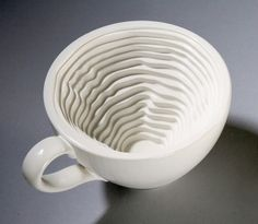 One week coffee cup [ via IOHANNA PANI ]   Unusual relief inside the cup will make classic cup unique.       From www.beautifullife.com