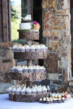 wedding cupcakes the base of wood is cute :) The idea of mini cupcakes is so cute for the kiddos