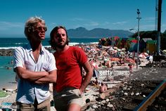 Gerry Beckley and Dewey Bunnel of folk-rock duo America stand by a beach in South Africa. The band is touring in 1981, when sanctions and boycotts against South African apartheid were in effect, including performing artists. America is best remembered for the anthemic 'A Horse with no Name'.