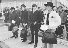 I love this picture because it looks like the dress code was black but John wore white and Paul is disgusted